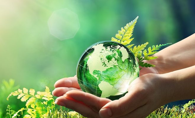 Holding world in hands green world sustainability
