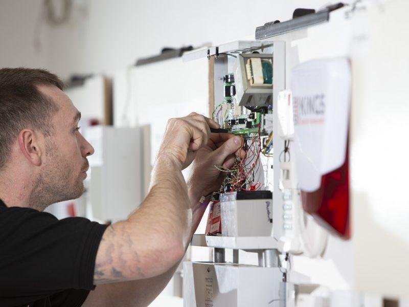 Engineer working on panel